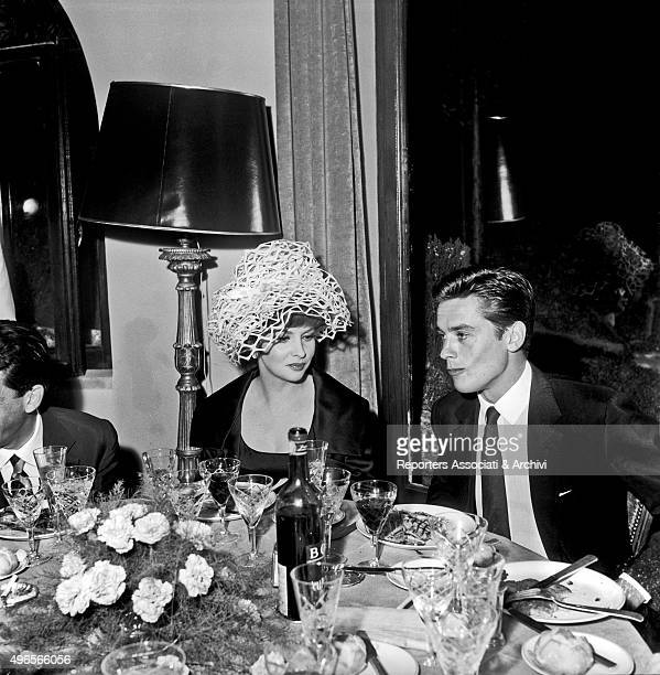 Italian actress Gina Lollobrigida wearing a strange hat at a dinner held in a villa in Grottaferrata Roma Castles together with French actor Alain...