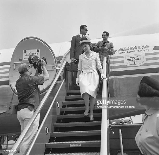 Italian actress Gina Lollobrigida wearing a tailleur gloves and a bowler hat getting down the stairs of an Alitalia airplane in Tessera airport Marco...