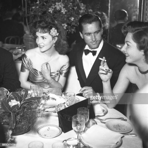 Italian actress Gina Lollobrigida with her husband Milko Skofic at dinner party Rome 1955