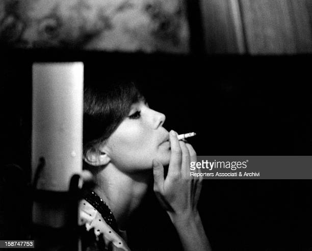 Italian actress Giorgia Moll smoking a cigarette Rome April 1961