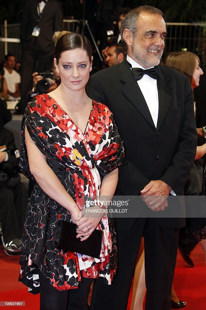 Italian actress Giovanna Mezzogiorno (L) and Head of Italy's national film museum Alberto Barbera arrive for the screening of 'La Nostra Vita' (Our Life) presented in competition at the 63rd Cannes Film Festival on May 20, 2010 in Cannes.