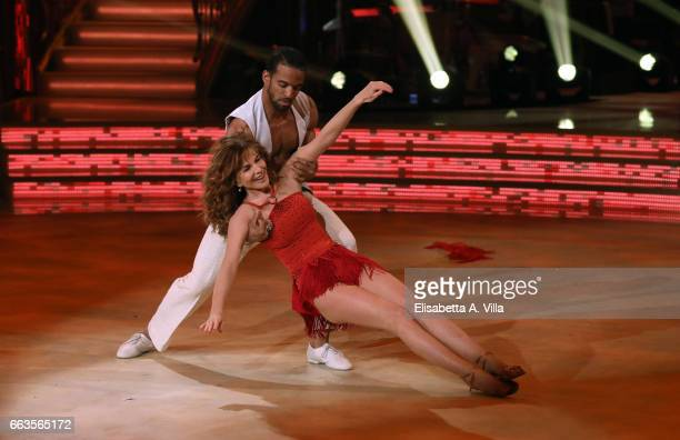 Italian actress Giuliana De Sio and her dance partner Maykel Fonts perform on the Italian TV show 'Ballando Con Le Stelle' at Auditorium Rai on April...