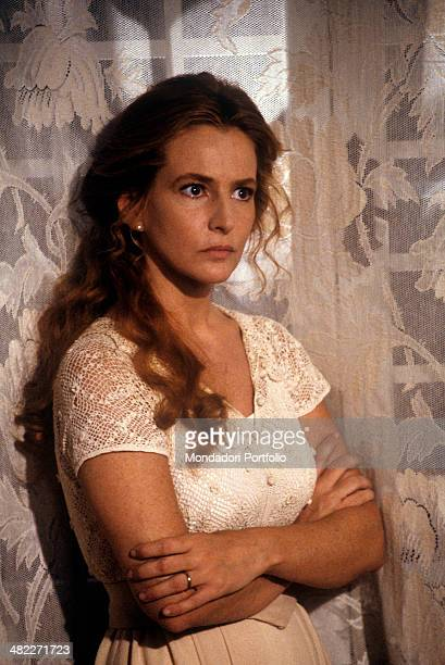 Italian actress Giuliana De Sio looking far with folded arms in the film The wicked Italy 1991