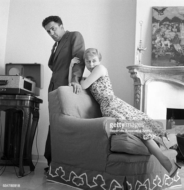 Italian actress Giulietta Masina and Italian director Federico Fellini posing at home 1957