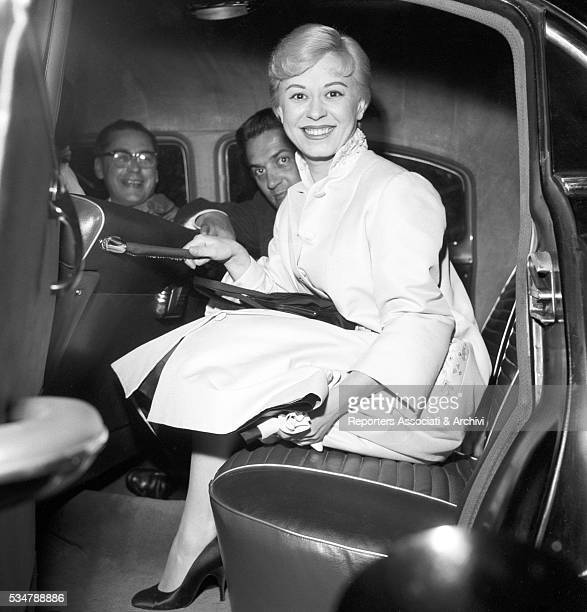 Italian actress Giulietta Masina and Italian director Federico Fellini in the car while they get the gala night for the film Nights of Cabiria 1956