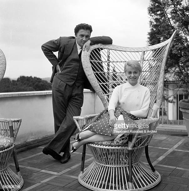 Italian actress Giulietta Masina and Italian director Federico Fellini on the terrace of their house 1956