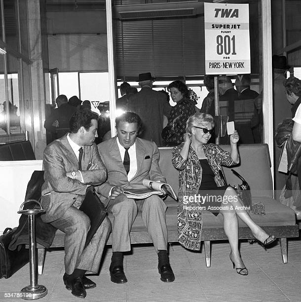 Italian actress Giulietta Masina and Italian director Federico Fellini waiting before leaving for Cannes from Ciampino Airport Ciampino 10th May 1960