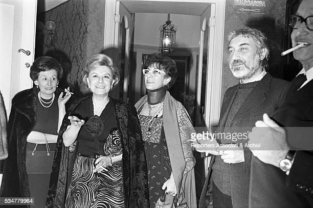 Italian actress Giulietta Masina and Italian director Lina Wertmuller getting out of a theater Italy 1976