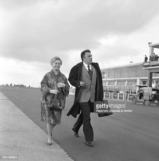 Italian actress Giulietta Masina coming along Italian director Federico Fellini flying to London from Ciampino airport for the premiere of the film...