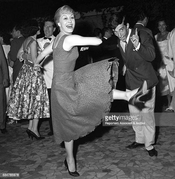 Italian actress Giulietta Masina dancing at the party for the Nastri d'Argento ceremony at Villa dei Cesari Rome 1956