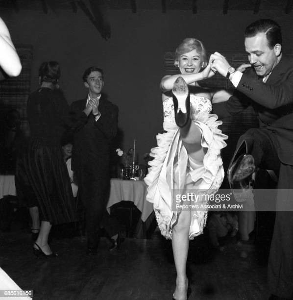 Italian actress Giulietta Masina dancing during a party at Rancho Grande Rome 1958