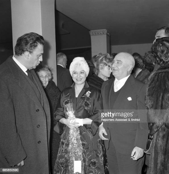 Italian actress Giulietta Masina Italian director Federico Fellini and Italian publisher Angelo Rizzoli at the gala for Behind Closed Shutters Rome...