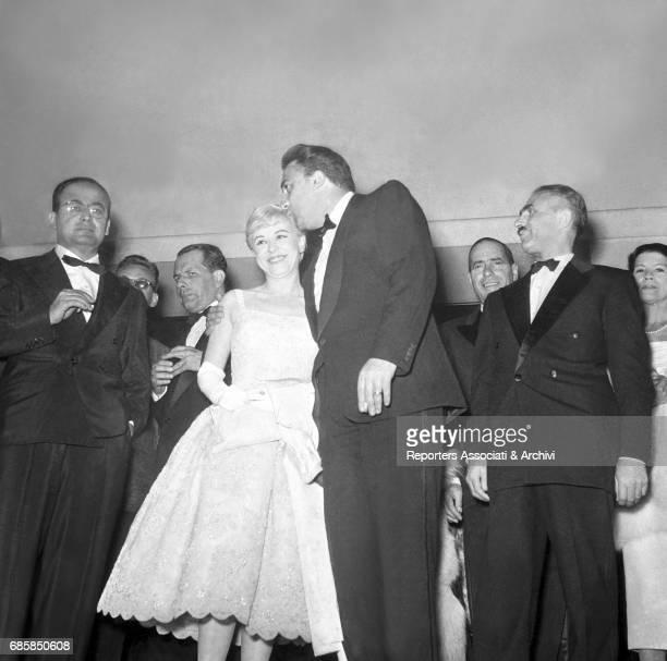 Italian actress Giulietta Masina Italian director Federico Fellini and Italian producer Dino De Laurentiis at the gala for Cabiria's Nights Italy 1956