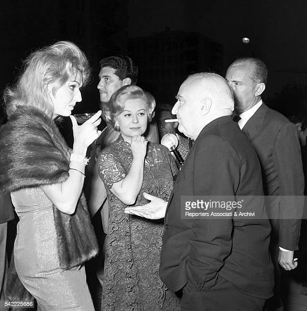 Italian actress Giulietta Masina Italian painter Anna Salvatore and Italian publisher Angelo Rizzoli chatting during a cocktail 1957