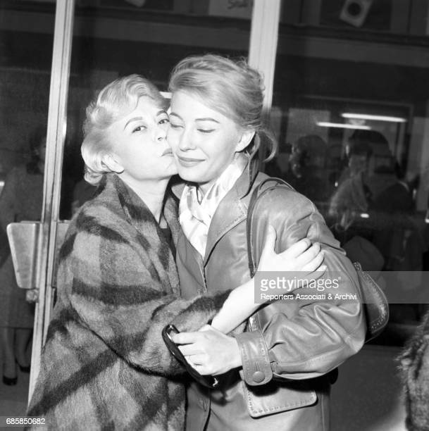 Italian actress Giulietta Masina kissing Italian actress Franca Bettoja in Ciampino airport before leaving for Berlin where she will act in a movie...