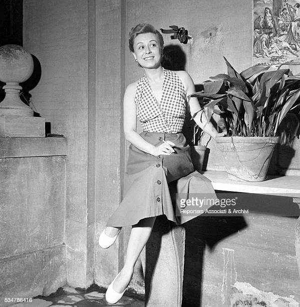 Italian actress Giulietta Masina posing on the terrace at home 1950
