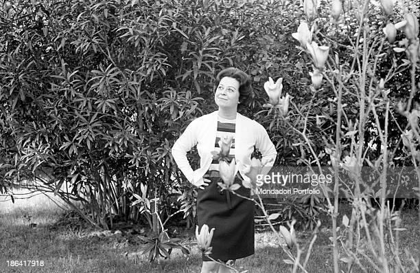 Italian actress Giulietta Masina posing with her hands on her hip in the garden of her house in Fregene. Fiumicino, 1967.