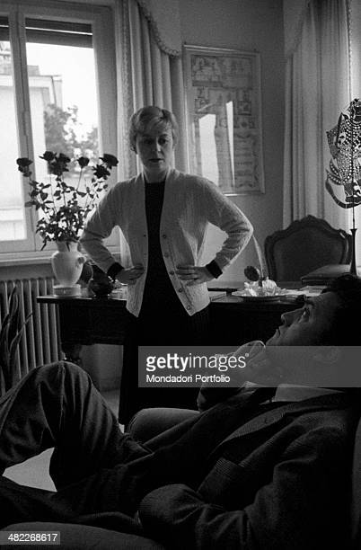 Italian actress Giulietta Masina pretending to be upset stares at her husband the famous director Federico Fellini who abandoned himself limply on...