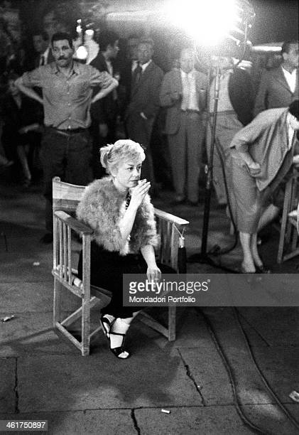 Italian actress Giulietta Masina smoking and drinking on the set of the film Nights of Cabiria 1957