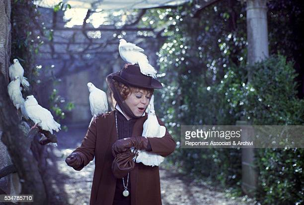 Italian actress Giulietta Masina surrounded by the doves in the film Don't Sting the Mosquito 1967
