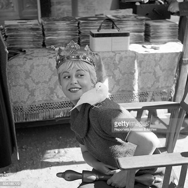 Italian actress Giulietta Masina with a dove on the shoulder on the set of the film Fortunella Rome 23rd September 1957