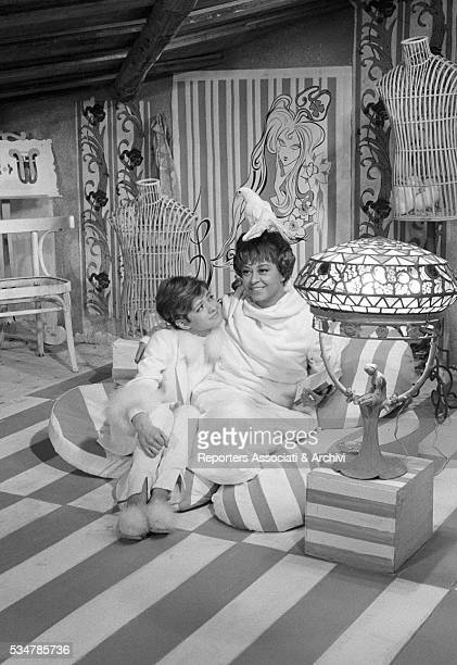 Italian actress Giulietta Masina with a white dove on her head beside Italian singer Rita Pavone in the film Don't Sting the Mosquito 1967