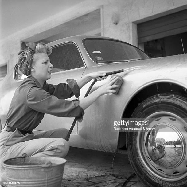 Italian actress Isa Barzizza washing a car Italy 1952