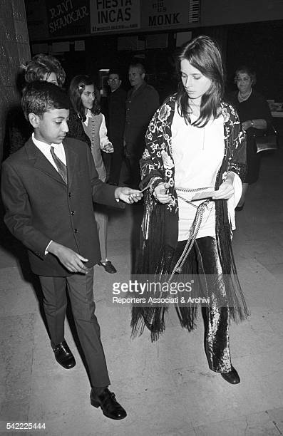 Italian actress Isabella Rossellini and her brother Gil Rossellini looking at their tickets at Sistina theater Rome 1969