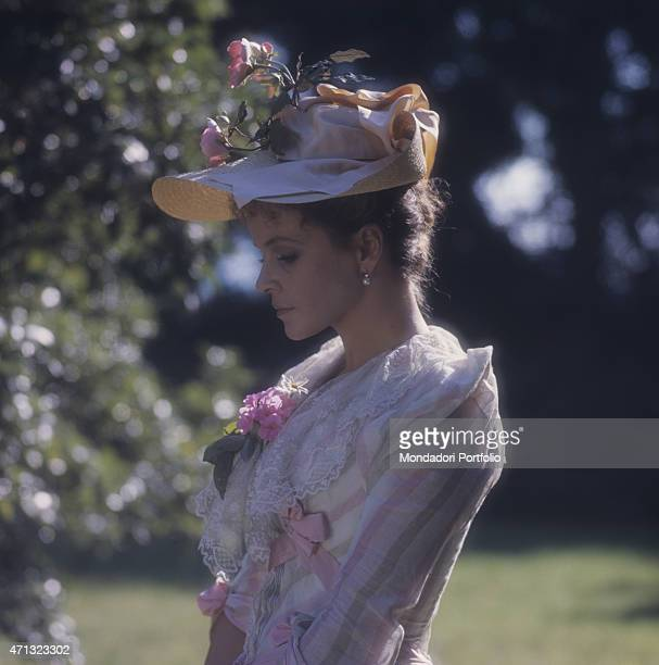 Italian actress Laura Antonelli posing in a stage costume and hat in the garden of a villa nearby Lucca on the set of the film The Innocent Italy 1976