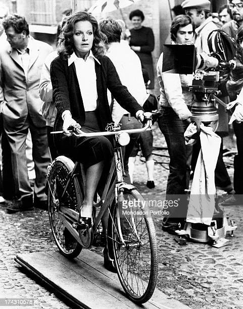 Italian actress Lisa Gastoni riding a bicycle and smoking on the set of Bitter Love Ferrara 1974