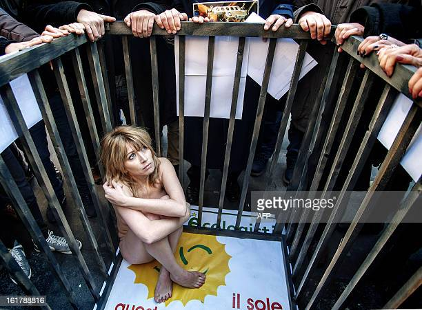 Italian actress Loredana Cannata sits in a cage during a protest performance against vivisection of animals in Naples on February 16 2013 AFP...