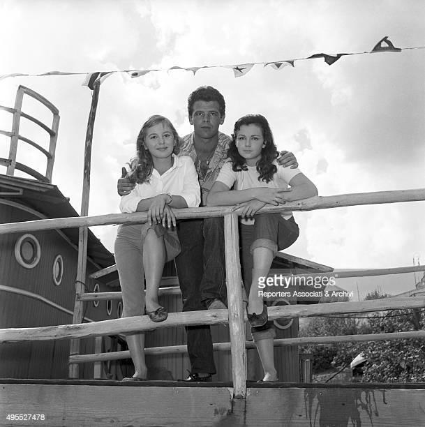 Italian actress Lorella De Luca standing at the parapet with Italian actor Renato Salvatori and Italian actress Marisa Allasio during a break on the...