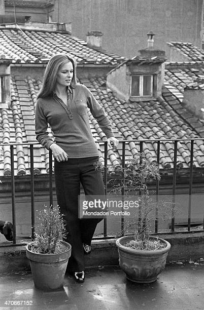 """""""Italian actress Lucia Bos, born Lucia Borloni, stands on the terrace of her Roman house leaning against the railing; she was noticed thanks to the..."""