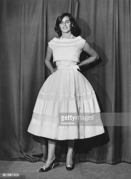 Italian actress Lucia Bosè tries on a dress at the Battilocchi atelier in Rome Italy 26th May 1956 She is choosing an outfit to wear for the...