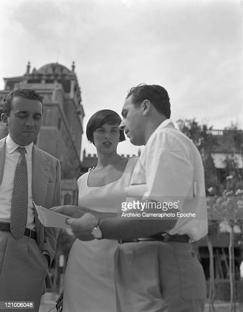 Italian actress Lucia Bosè wearing a dress portrayed outside of the Excelsior Hotel with Stefano Carretta and Franco Villani Lido Venice 1950