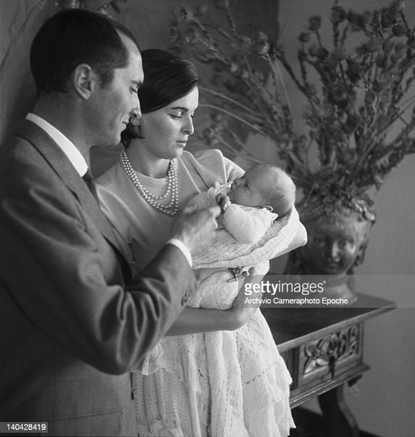 Italian actress Lucia Bose and the bullfighter Luis Miguel Dominguin holding the newborn Paola Dominguin Bose, Madrid, 1961.