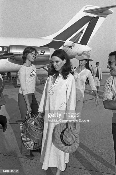 Italian actress Lucia Bose at the airport with his son Miguel Bose, Lido, Venice, 1972.