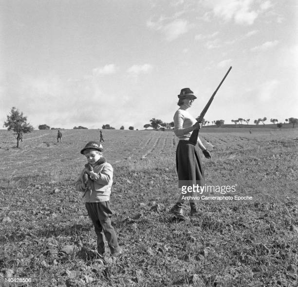 Italian actress Lucia Bose hunting with his son Miguel Bose, Madrid, 1961.