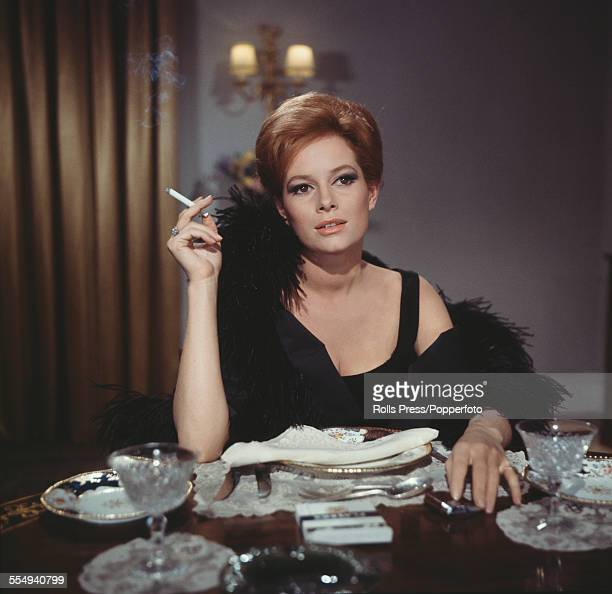 Italian actress Luciana Paluzzi pictured playing the character of Fiona Volpe smoking a cigarette in a scene from the James Bond film 'Thunderball'...