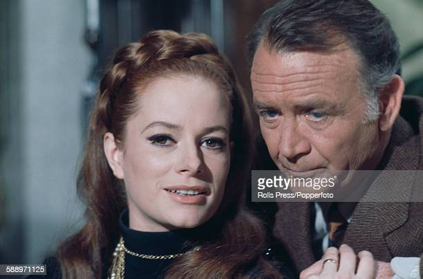 Italian actress Luciana Paluzzi pictured with English actor John Mills in a scene from the film 'A Black Veil for Lisa' in Italy in March 1968