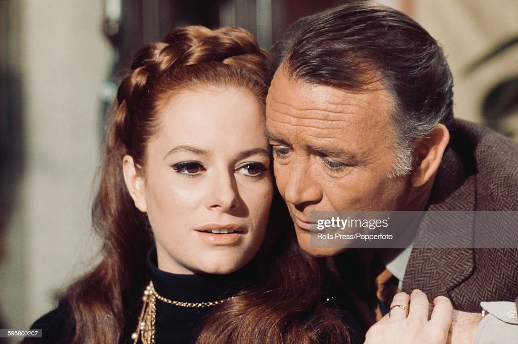 Italian actress Luciana Paluzzi pictured with English actor John Mills (1908-2005) in a scene from the film 'A Black Veil for Lisa' in Italy on 15th March 1968.