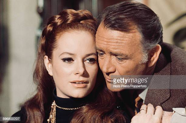 Italian actress Luciana Paluzzi pictured with English actor John Mills in a scene from the film 'A Black Veil for Lisa' in Italy on 15th March 1968