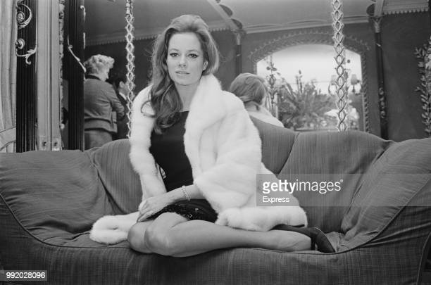 Italian actress Luciana Paluzzi, who stars as the villain Fiona Volpe in the James Bond film Thunderball, pictured wearing a fur coat in London on...