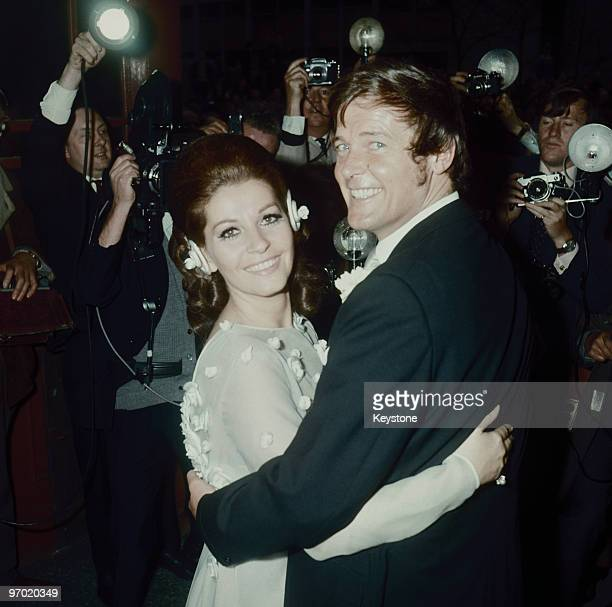Italian actress Luisa Mattioli and English actor Roger Moore outside Caxton Hall London after their wedding ceremony 11th April 1969