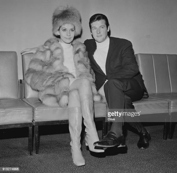 Italian actress Luisa Mattioli with her partner British actor Roger Moore at Heathrow Airport London UK 12th February 1968