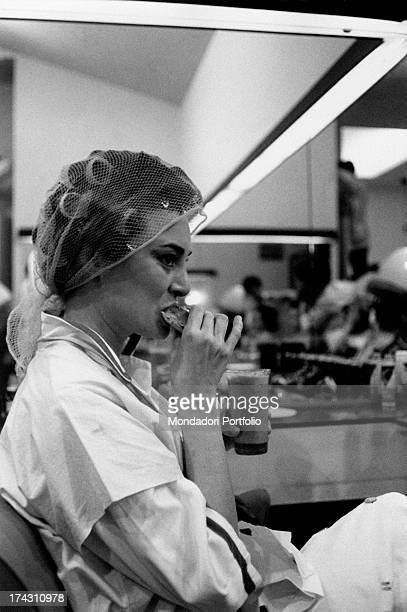Italian actress Lydia Alfonsi eating something at the hair stylist 1960