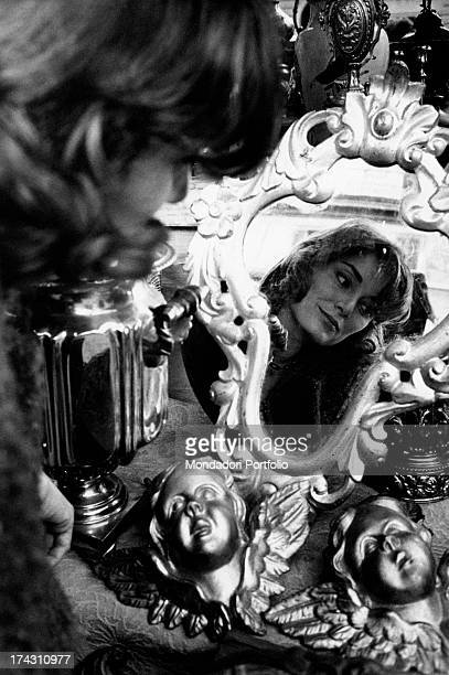 Italian actress Lydia Alfonsi looking at herself in a mirror 1960
