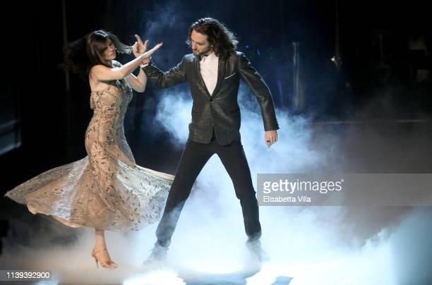 Italian actress Manuela Arcuri and her dance partner Luca Favilla perform on the tv show Ballando Con Le Stelle at RAI Auditorium on March 30 2019 in...