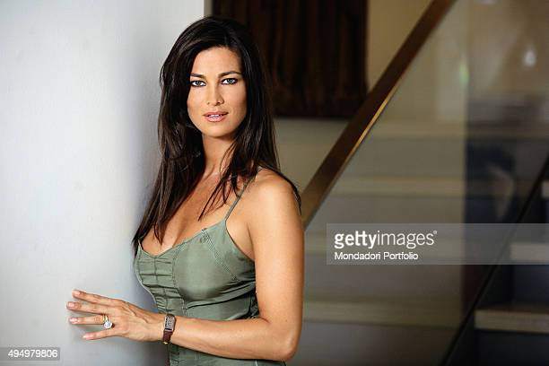 Italian actress Manuela Arcuri posing in a silk dress for a photo shooting beside a staircase Italy 22nd April 2008