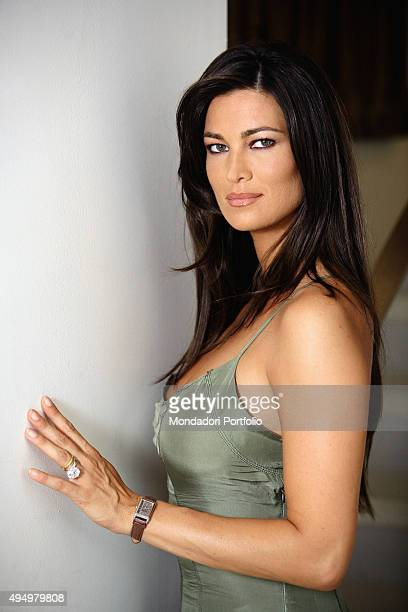 Italian actress Manuela Arcuri posing in a silk dress for a photo shooting beside a wall Italy 22nd April 2008